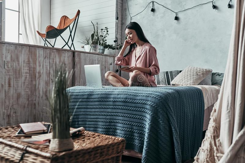 Beauty surfing the net. Attractive young woman using computer an stock image
