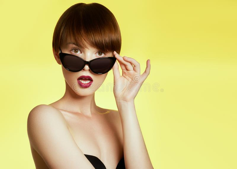 Beauty surprised fashion funny model girl wearing sunglasses. Young girl. Expressing positive emotions, smile. Beautiful. Woman royalty free stock photos