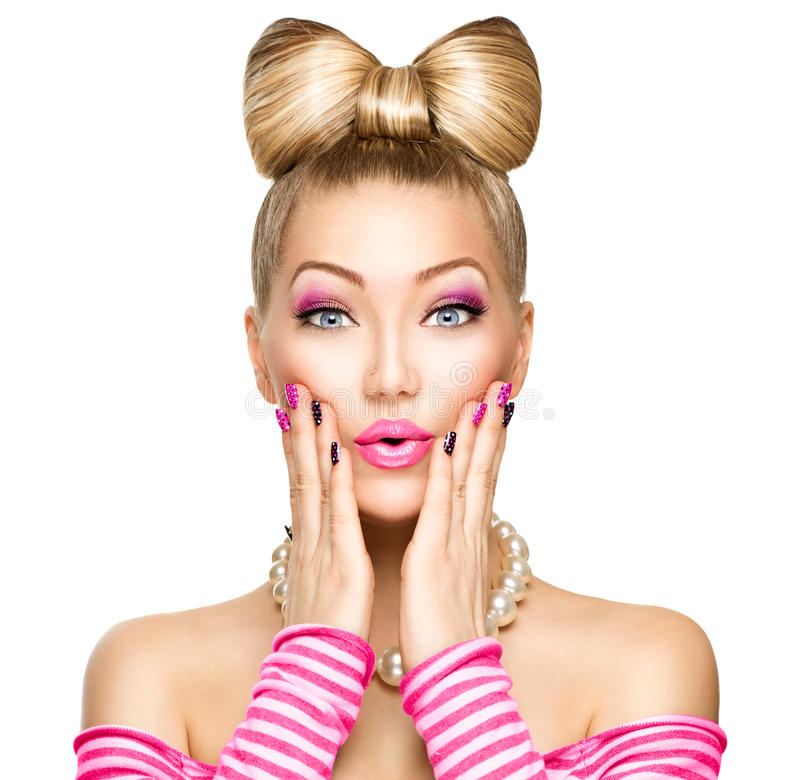 Beauty surprised girl with funny bow hairstyle. Beauty surprised fashion model girl with funny bow hairstyle stock images