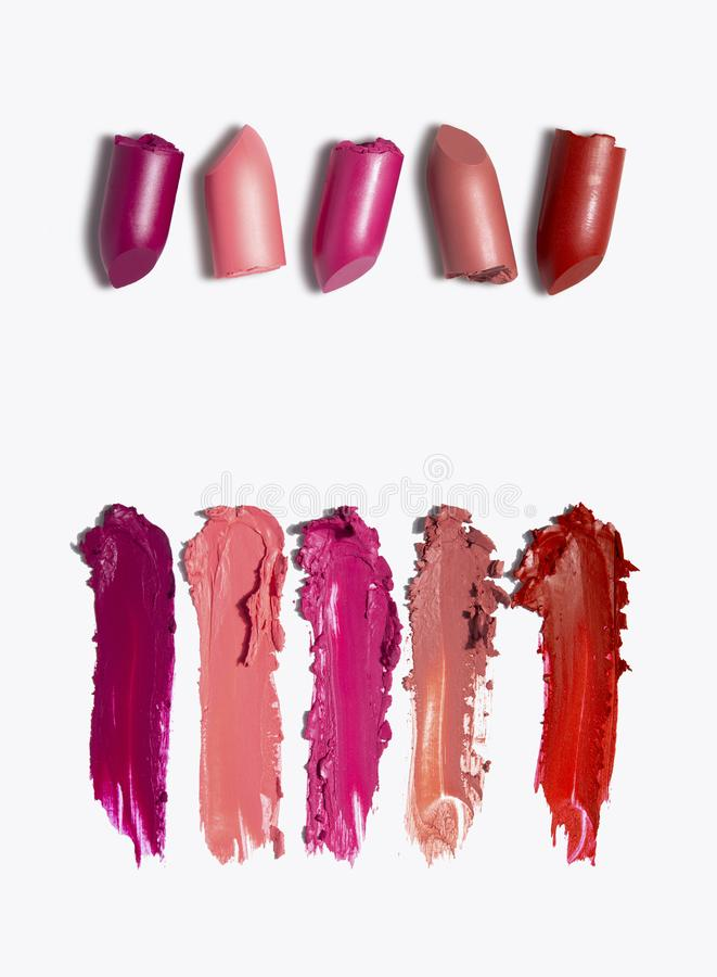 Beauty swatches. Creative concept photo of cosmetics swatches beauty products lipstick on white background royalty free stock photography