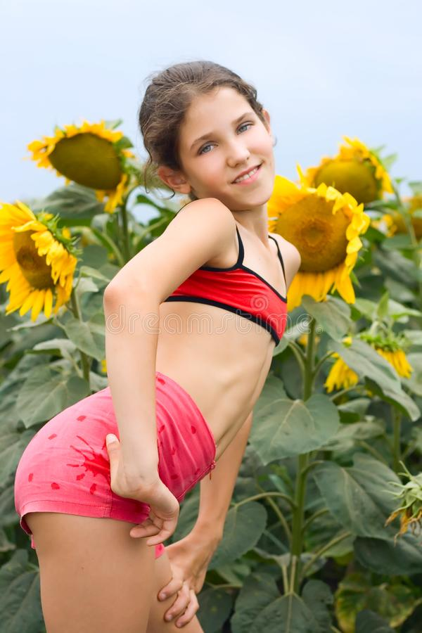 Download Beauty Teen Girl And Sunflowers Stock Photo - Image of person, free: 9680534