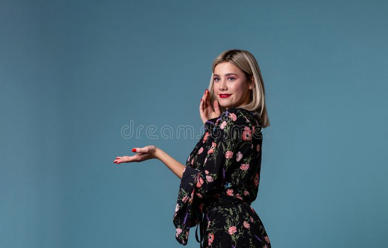 Beauty teenage girl showing empty copy space royalty free stock photography