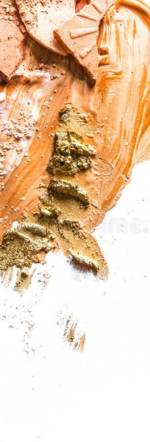 Crushed eyeshadow, powder and liquid foundation close-up isolated on white background. Beauty texture, cosmetic product and art of make-up concept - Crushed stock photos