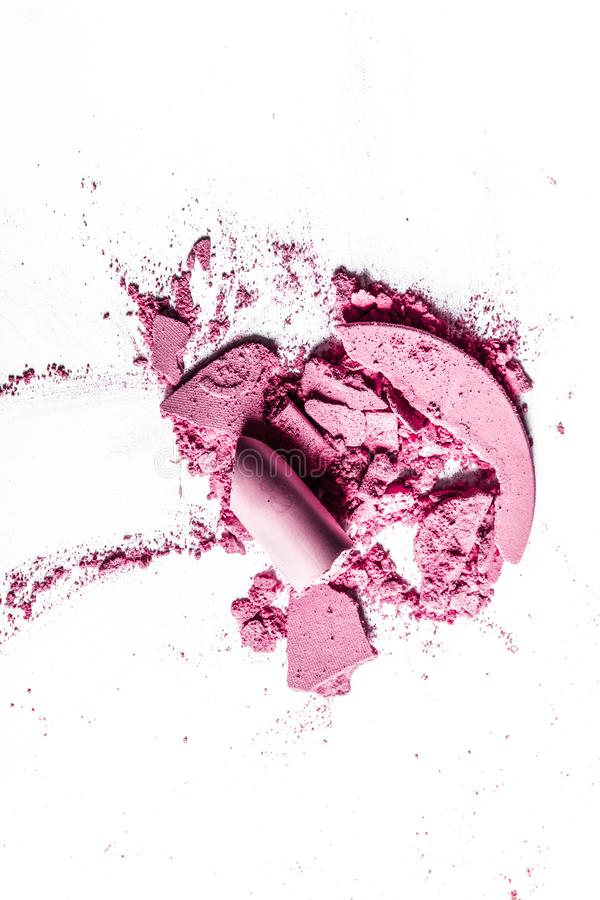 Crushed eyeshadows, lipstick and powder isolated on white background. Beauty texture, cosmetic product and art of make-up concept - Crushed eyeshadows, lipstick royalty free stock photography