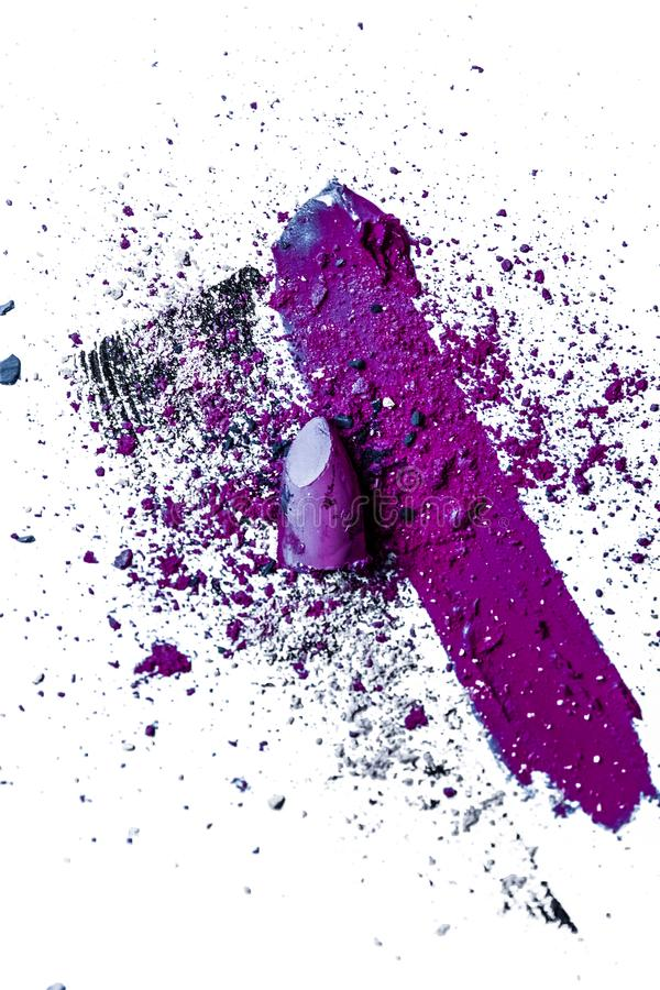 Lipstick smudge, mascara stroke and crushed eyeshadow isolated on white background. Beauty texture, cosmetic product and art of make-up concept - Lipstick smudge royalty free stock photo