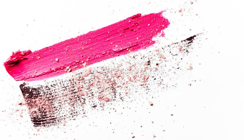 Lipstick smudge, mascara stroke and crushed eyeshadow isolated on white background. Beauty texture, cosmetic product and art of make-up concept - Lipstick smudge stock images