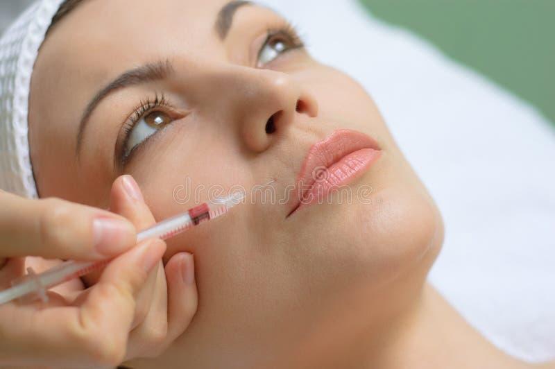 Beauty treatment, botox injection stock photo