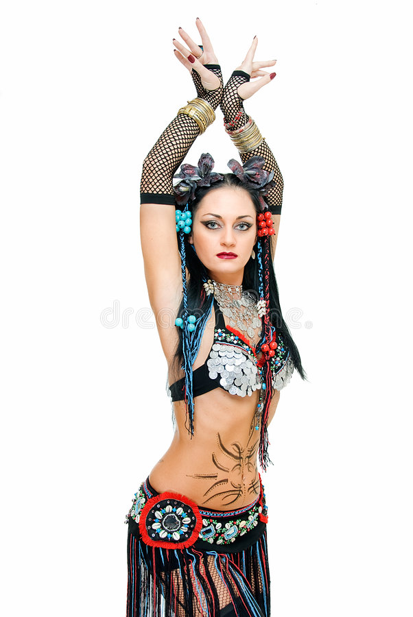 Beauty tribal. Alluring young tribal dancer in pose on white royalty free stock images