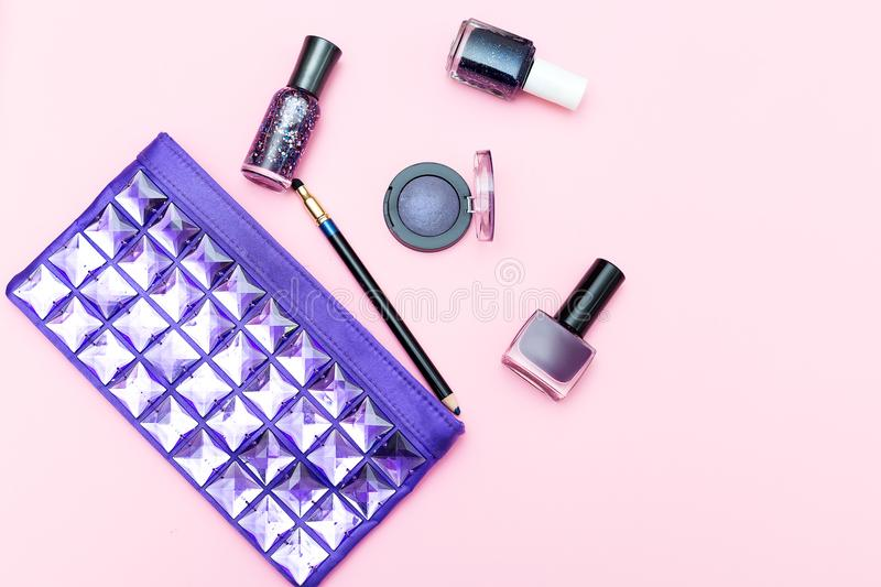Beauty of ultraviolet color and cosmetics on a pink background. Top view royalty free stock photo