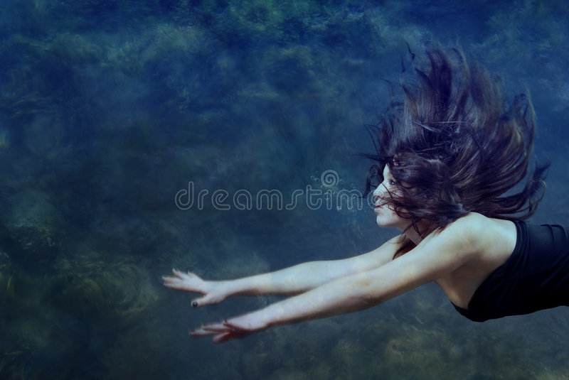 Beauty underwater. Beautiful lady swimming and diving underwater