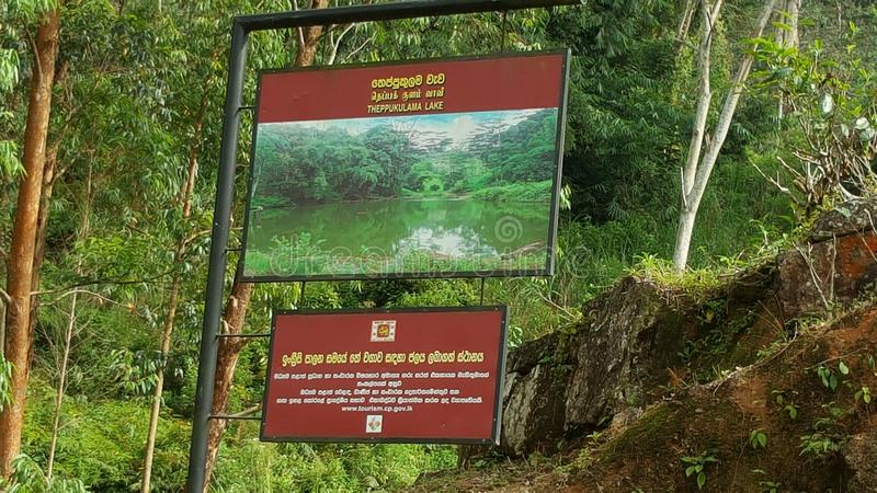 Beauty of up country in Sri Lanka. This beautiful site is located in Nawalapitiya - Dolosbage road, Central province, Sri Lanka. This board is near a lake which stock photography