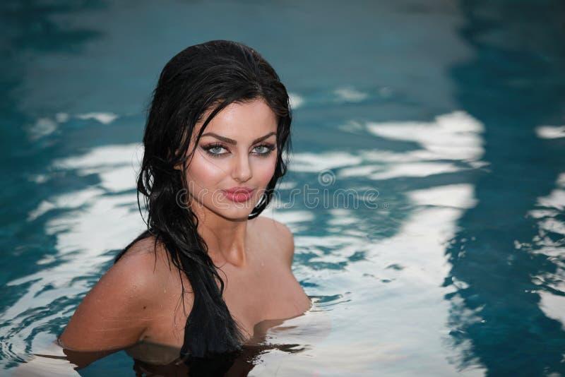 Beauty in water. Pretty woman halfway in water stock photo