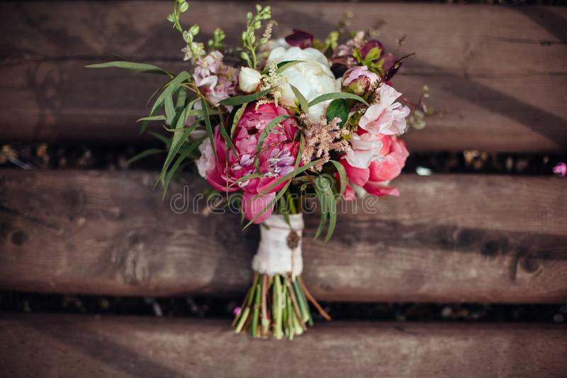 Beauty wedding bouquet on wooden background, wedding decoration royalty free stock photo