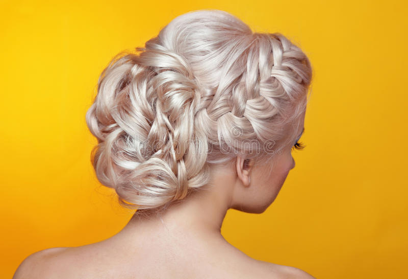 Beauty wedding hairstyle. Bride. Blond girl with curly hair styling royalty free stock photography