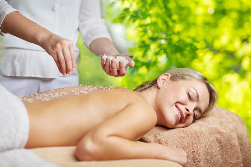 Woman having salt massage in spa royalty free stock photography