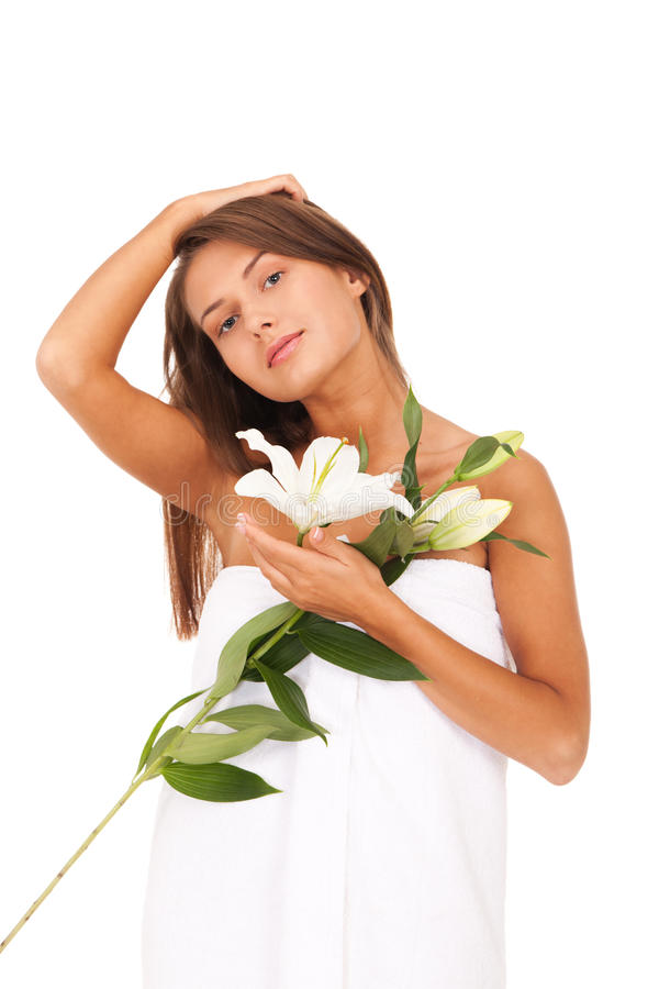 Beauty with white lily. Young lady with white lily isolated on white background stock photo