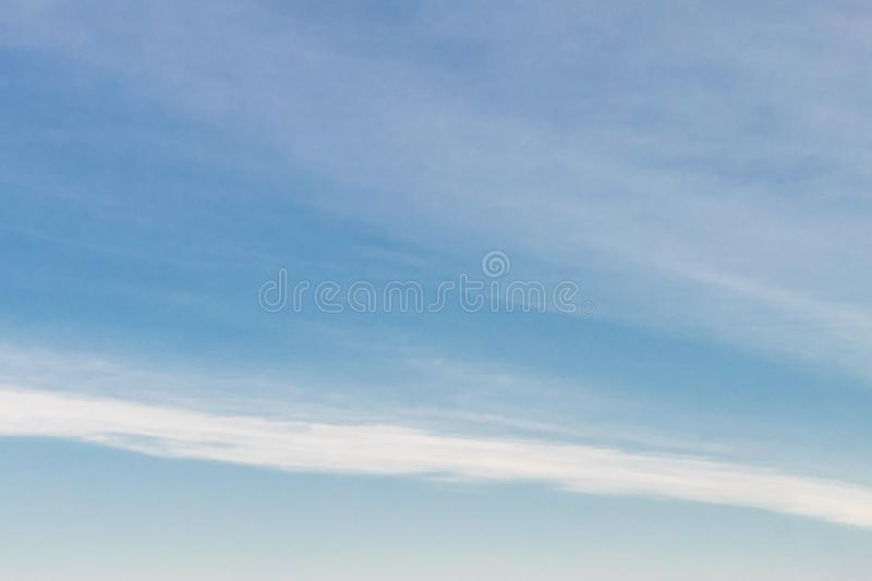 Beauty white tiny clouds and clear blue sky in sunny day texture background. Soft focus, copy space stock photo