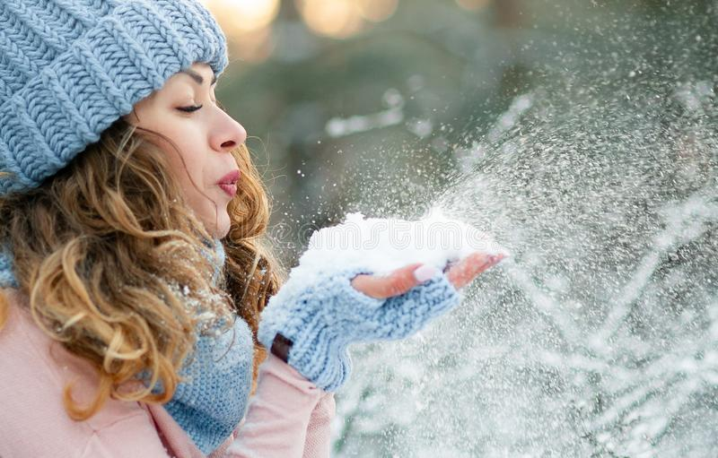 Attractive young curly woman in wintertime outdoor royalty free stock photography