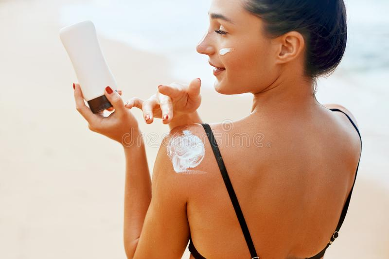 Beauty Woman applying sunscreen creme. Skin care. Body Sun protection sun cream. royalty free stock photo