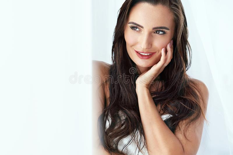 Beauty. Woman With Beautiful Face And Smooth Skin, Brown Hair royalty free stock photography