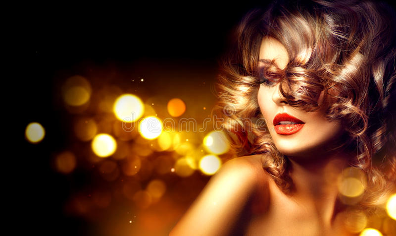Beauty woman with beautiful makeup and curly hairstyle. Over holiday dark background stock photos