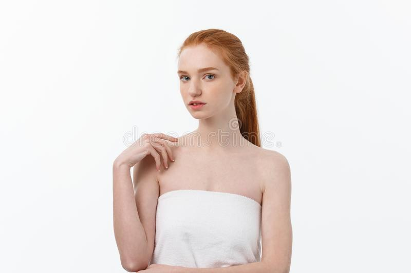 Beauty Woman. Beautiful Young Female touching Her Skin. Portrait isolated on White Background. Healthcare. Perfect Skin royalty free stock photo