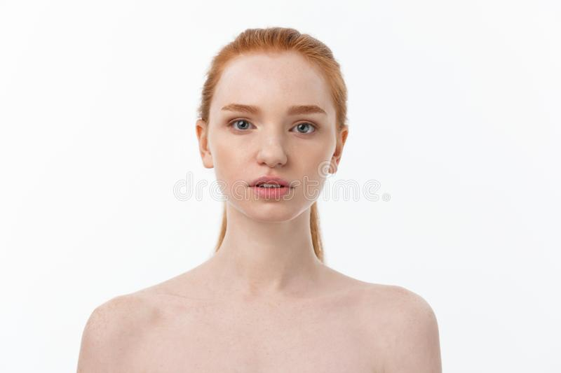 Beauty Woman. Beautiful Young Female touching Her Skin. Portrait isolated on White Background. Healthcare. Perfect Skin stock photos