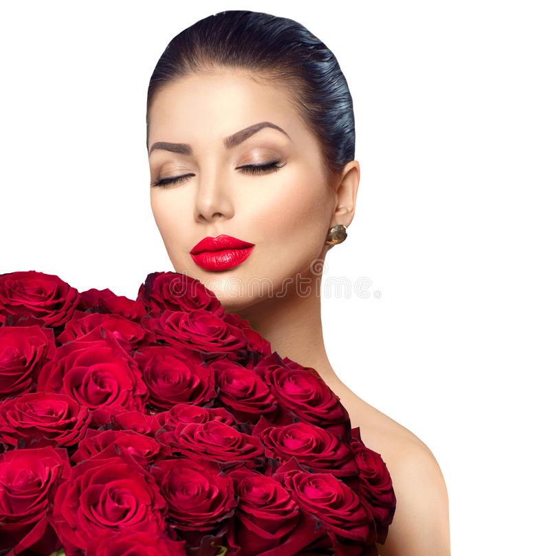 Beauty woman with big bouquet of red roses. Beauty fashion model woman with big bouquet of red roses royalty free stock photo