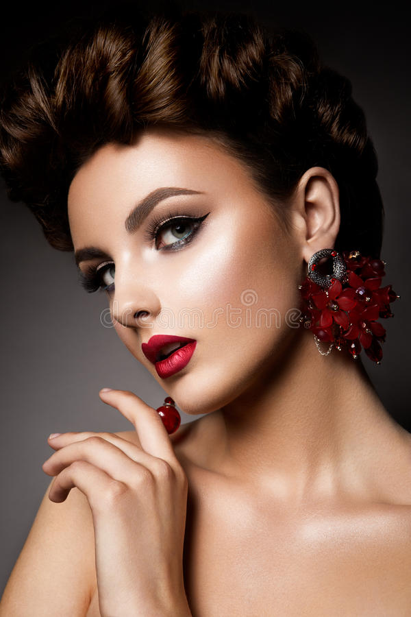 Beauty woman with blue eyes and red lips. royalty free stock images