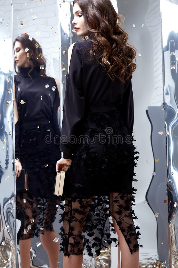 Beauty woman brunette curly hair makeup cosmetic face wear black. Skinny dress elegant style for celebrate party holiday Christmas New Year Valentine`s Day royalty free stock photo