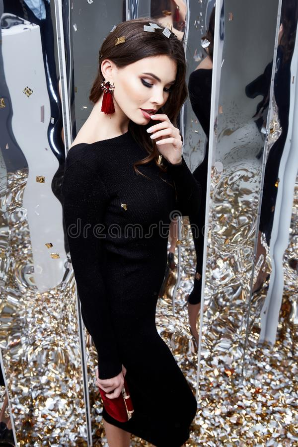 Beauty woman brunette curly hair makeup cosmetic face wear black. Skinny dress elegant style for celebrate party holiday Christmas New Year Valentine`s Day royalty free stock image