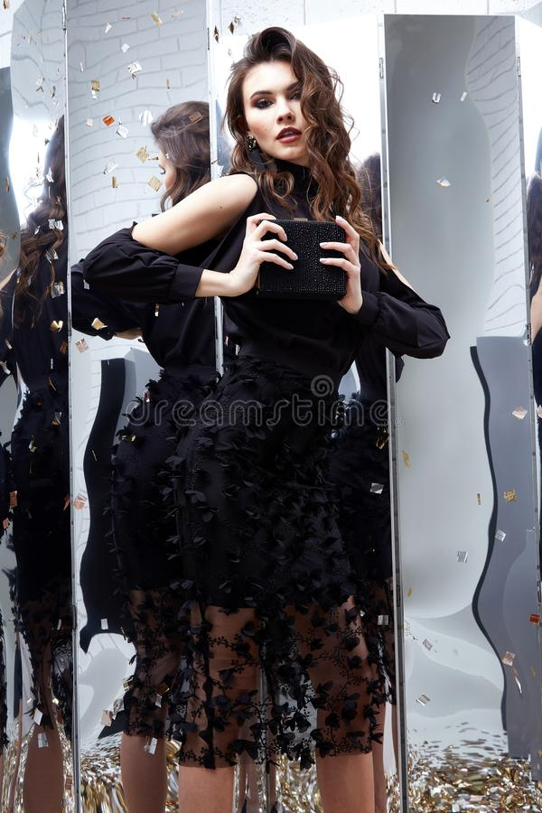 Beauty woman brunette curly hair makeup cosmetic face wear black. Skinny dress elegant style for celebrate party holiday Christmas New Year Valentine`s Day royalty free stock photos