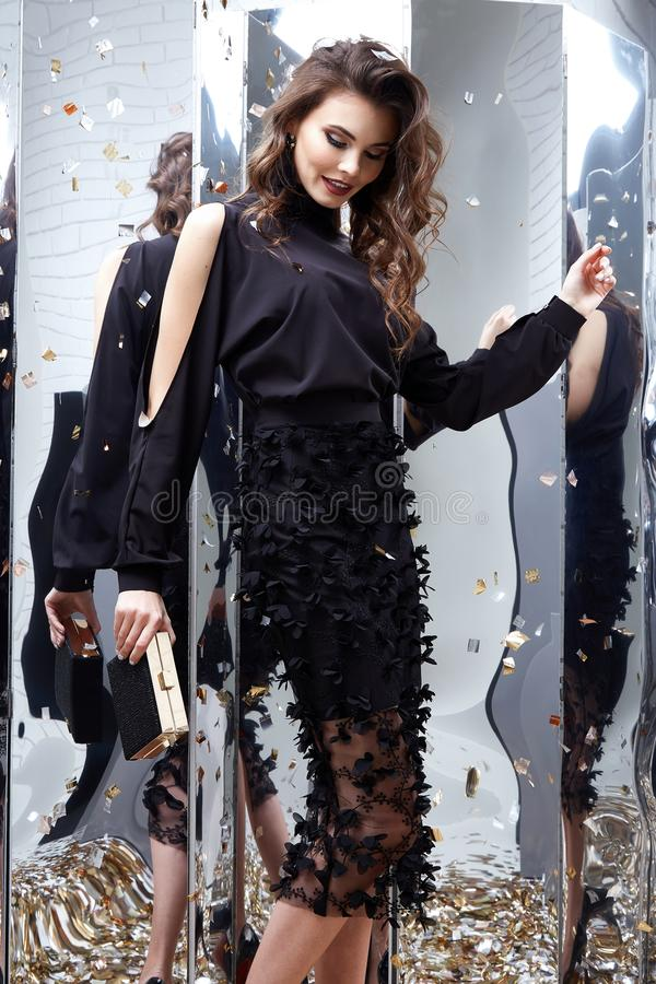 Beauty woman brunette curly hair makeup cosmetic face wear black. Skinny dress elegant style for celebrate party holiday Christmas New Year Valentine`s Day stock photos