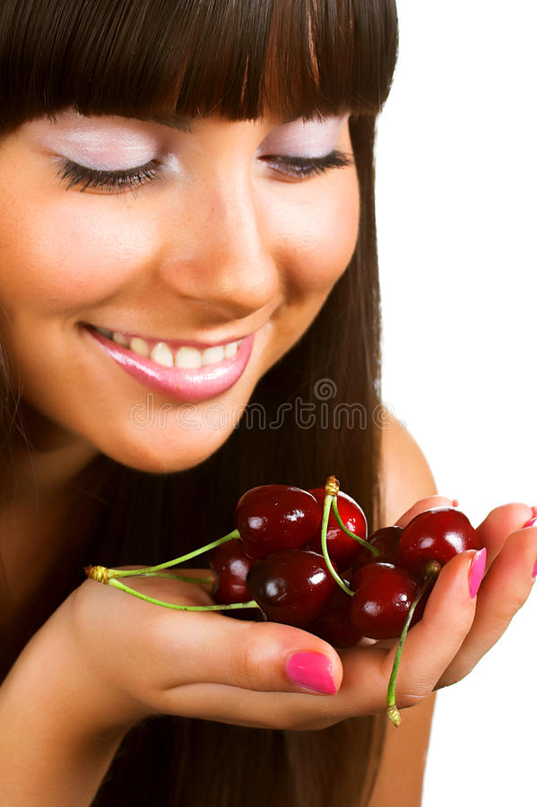 Beauty woman with cherries on white royalty free stock image