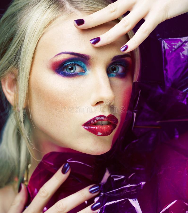 Beauty woman with creative make up, many fingers on face close up. Agressive halloween look royalty free stock photography