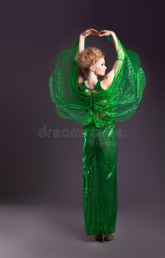 Beauty woman dance in transparent green cloth royalty free stock images