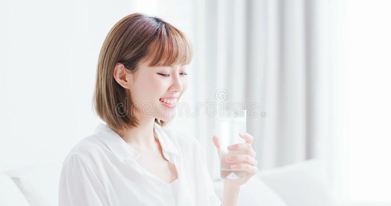Beauty woman drink water happily royalty free stock photos