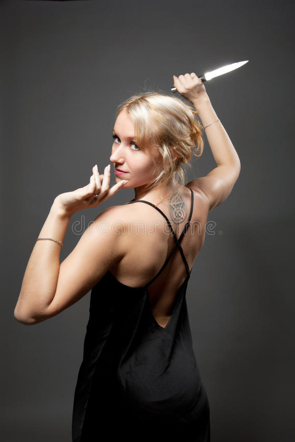 Beauty woman in evening dress with ritual knife royalty free stock photos