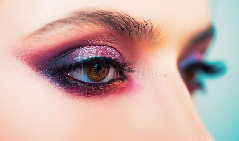 Beauty woman eyes with fashion make up. Beautiful young girl in studio on gray background. stock photo