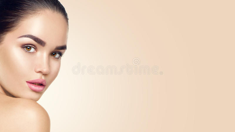 Beauty woman face. Beautiful brunette young model girl with perfect ski royalty free stock image