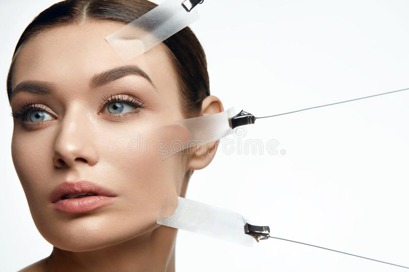 Beauty Woman Face During Face Skin Lift Treatment. On White Background. High Resolution royalty free stock images