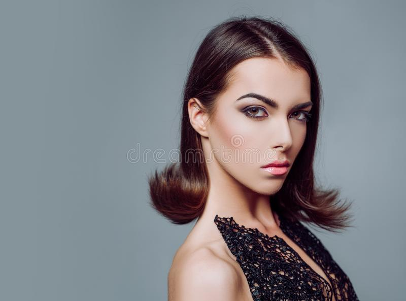 Beauty woman face. Makeup, smooth skin. Advertisement, magazine. Art design, make up. Close-up portrait. Hairstyle stock photography