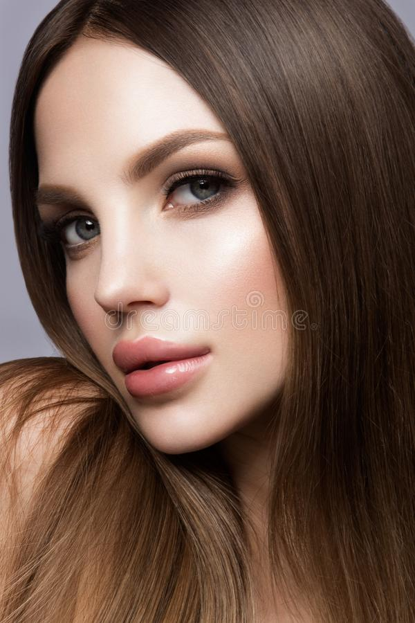 Beauty Woman face Portrait. Beautiful model Girl with Perfect Fresh Clean Skin stock photography