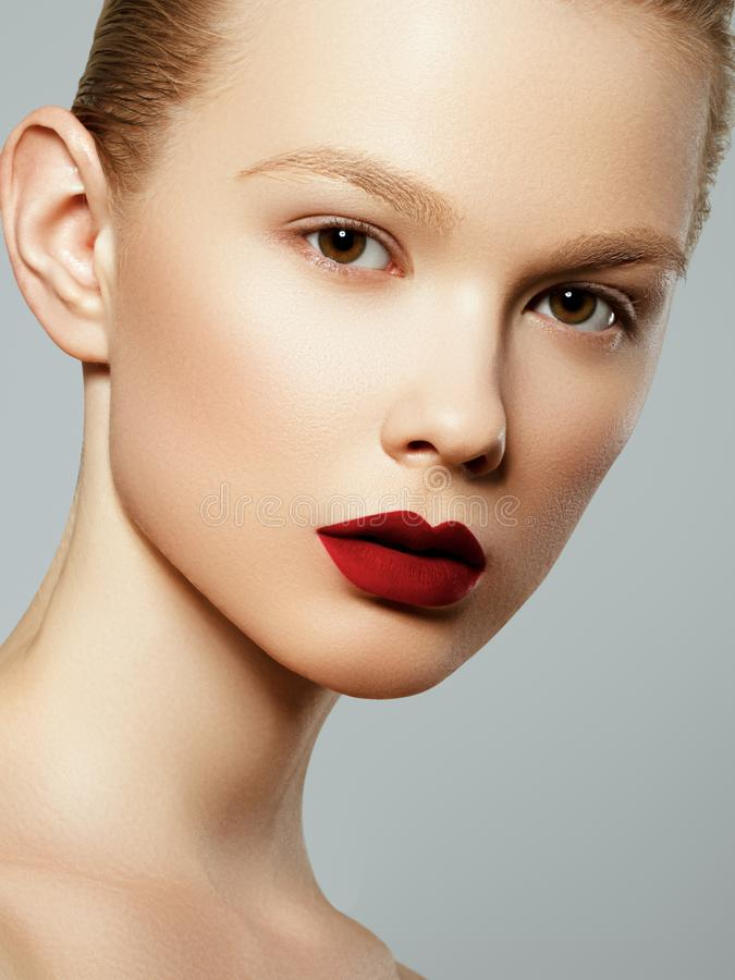 Beauty woman Face. Portrait of beautiful sexy young female with perfect matte facial makeup. Soft healthy skin royalty free stock images