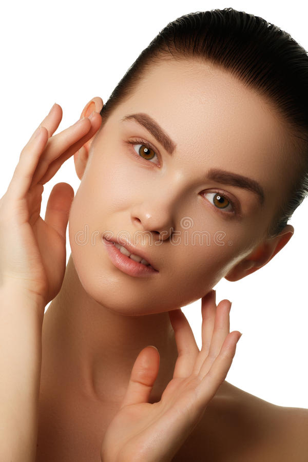 Beauty Woman face portrait. Beautiful spa model girl with perfect fresh clean skin. Female looking at camera and smiling. Youth royalty free stock images