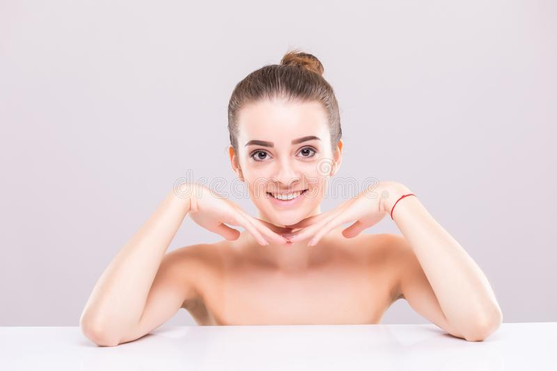 Beauty woman face portrait. Beautiful spa model girl with perfect fresh clean skin. Female looking at camera. Youth and skin care stock photo