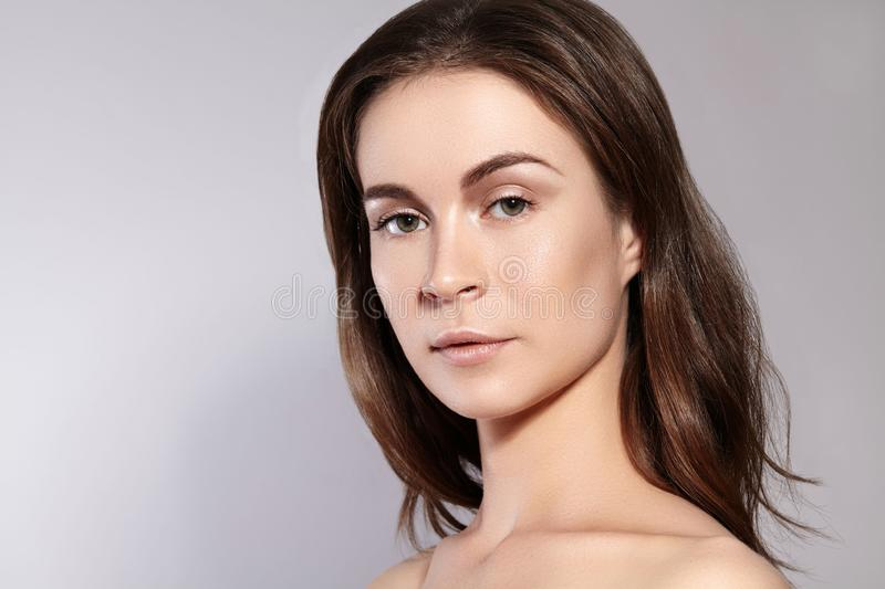 Beauty Woman Face Portrait. Beautiful Spa Model Girl with Perfect Fresh Clean Skin. Youth and Skin Care Concept royalty free stock photography