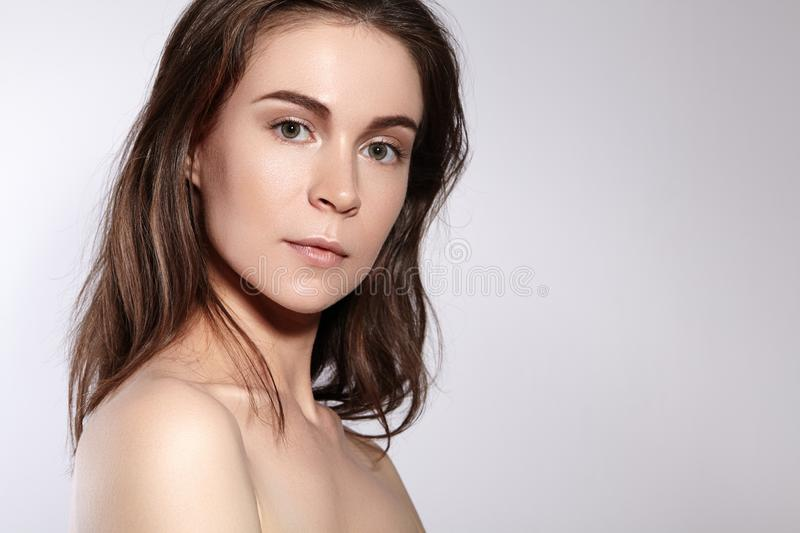 Beauty Woman Face Portrait. Beautiful Spa Model Girl with Perfect Fresh Clean Skin. Youth and Skin Care Concept royalty free stock image