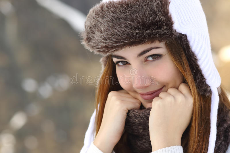 Beauty woman face portrait warmly clothed in winter. Holding a scarf outdoors royalty free stock photos
