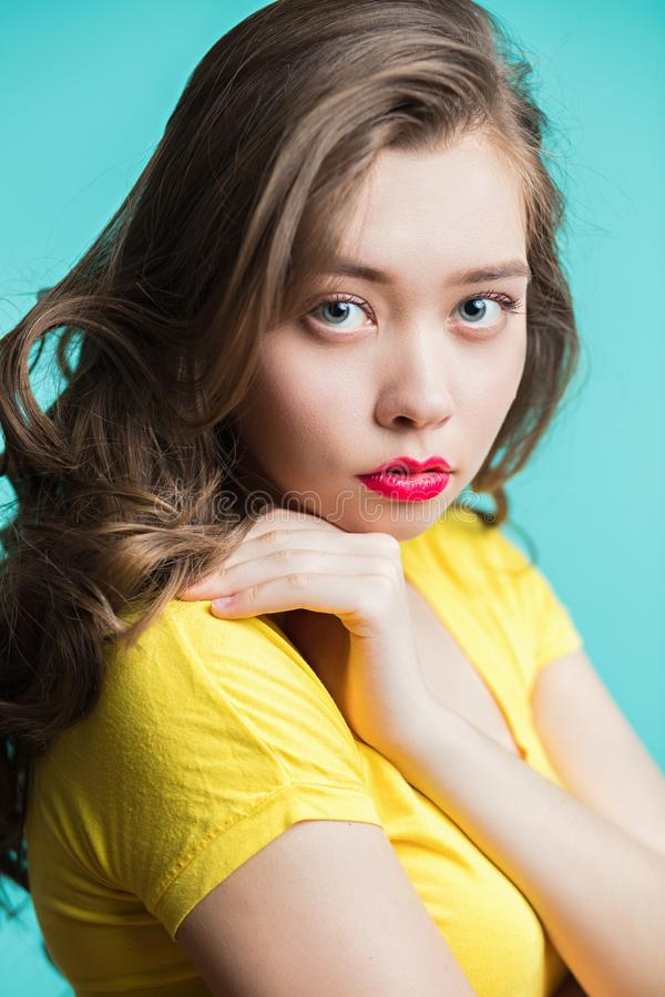 Beauty woman face portrait. Young girl with red lips piercing stock photo